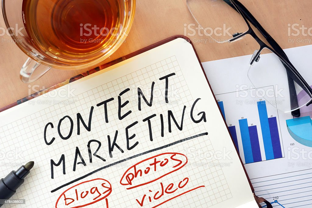 Notepad with words content marketing  concept and glasses stock photo