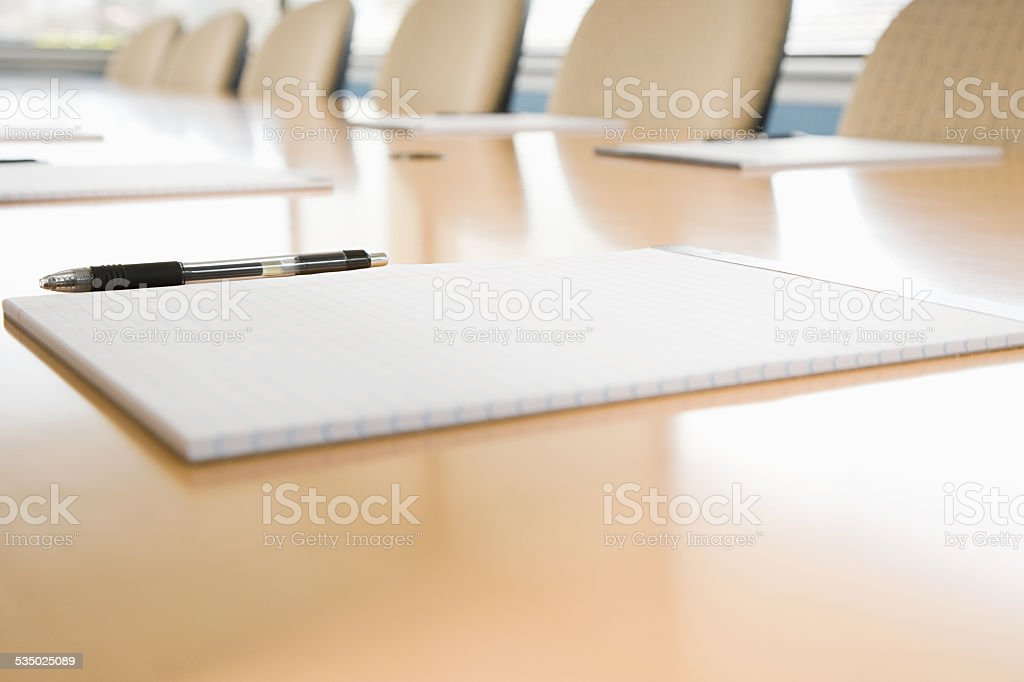 Notepads on conference table stock photo