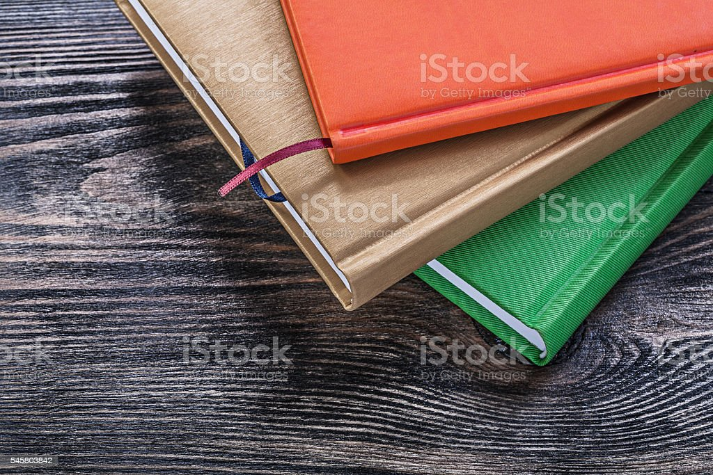 Notepads on vintage wooden board education concept stock photo