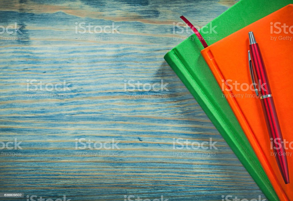 Notepads pen on wooden board education concept stock photo