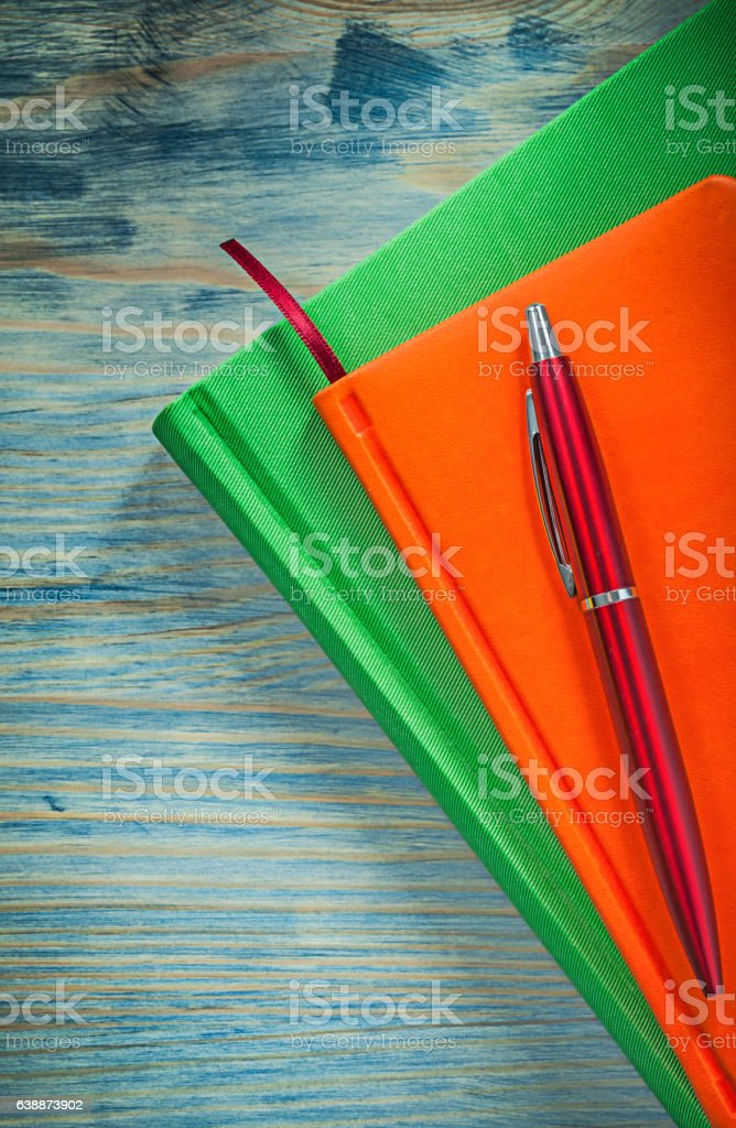 Notepads pen on wooden board office concept stock photo