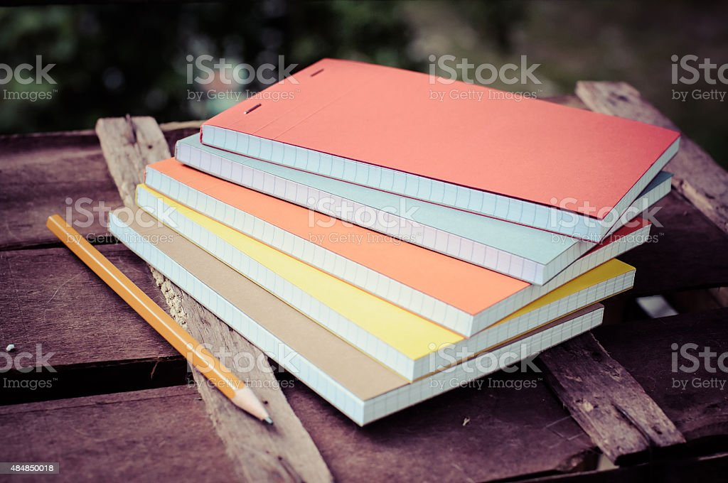 notepads with pen stock photo