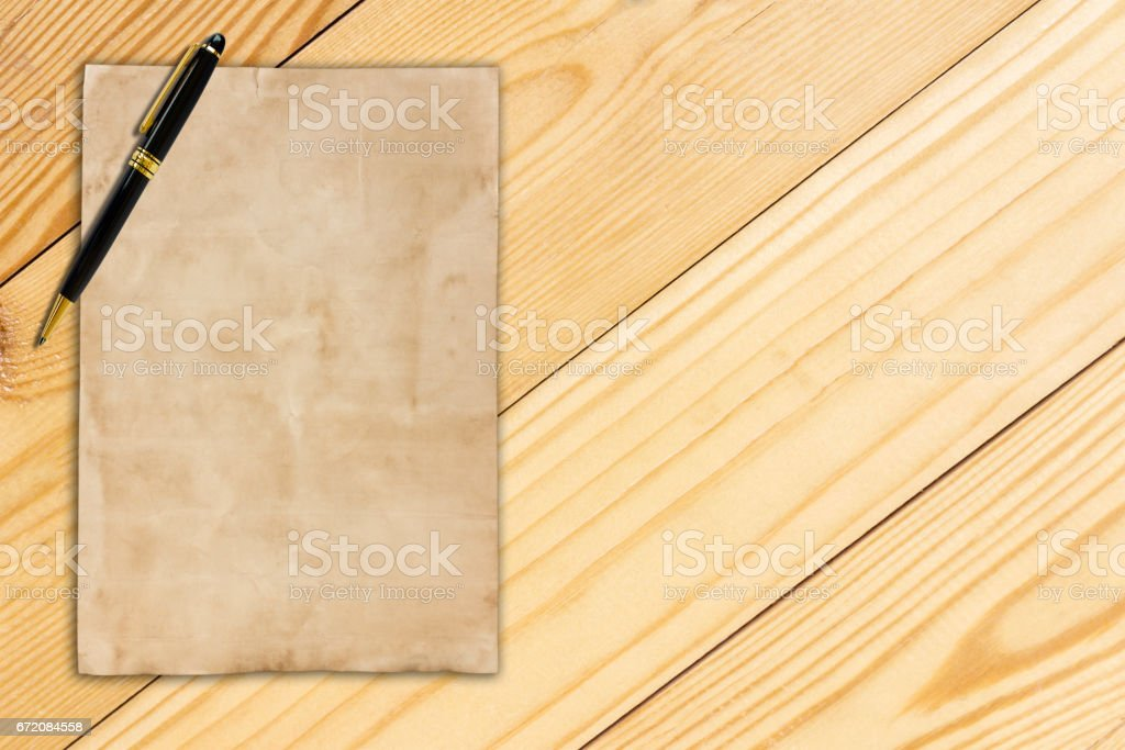 notepaper and pen on wooden background stock photo