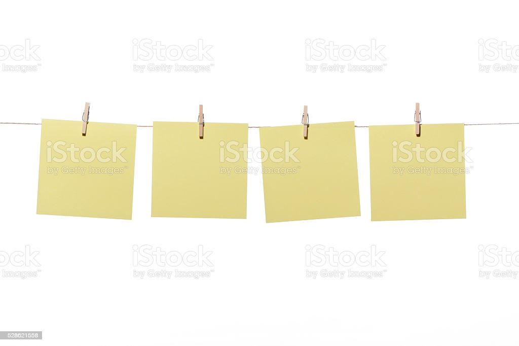 Notes or posit hanging wooden pegs stock photo