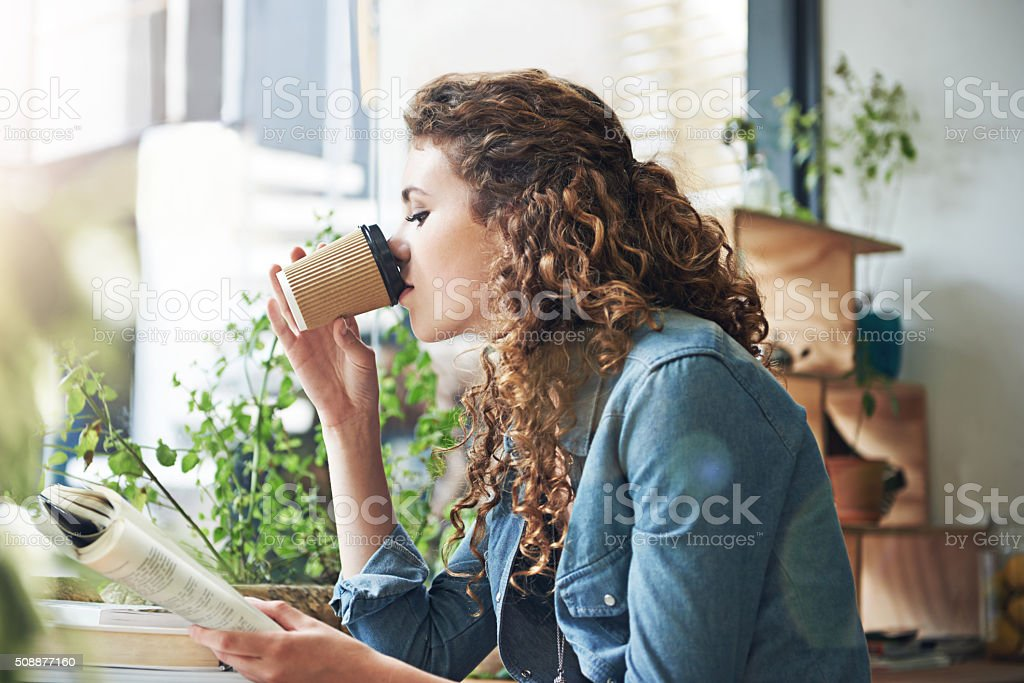 Nothing better than good coffee and a great book stock photo