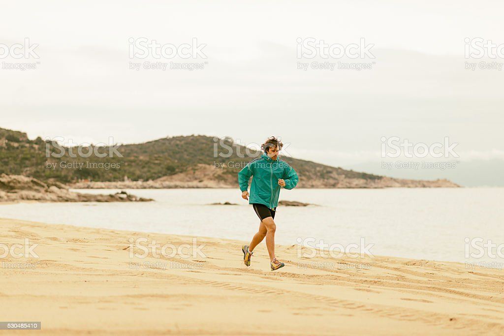 Nothing better than jogging by the sea shore in Greece. stock photo