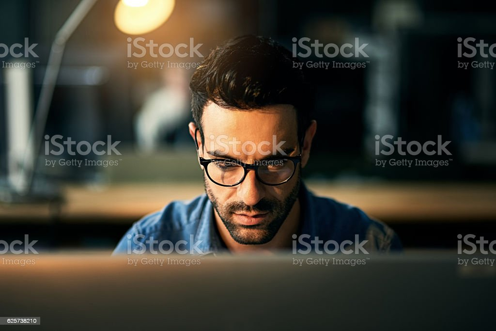 Nothing comes between him and his deadline stock photo