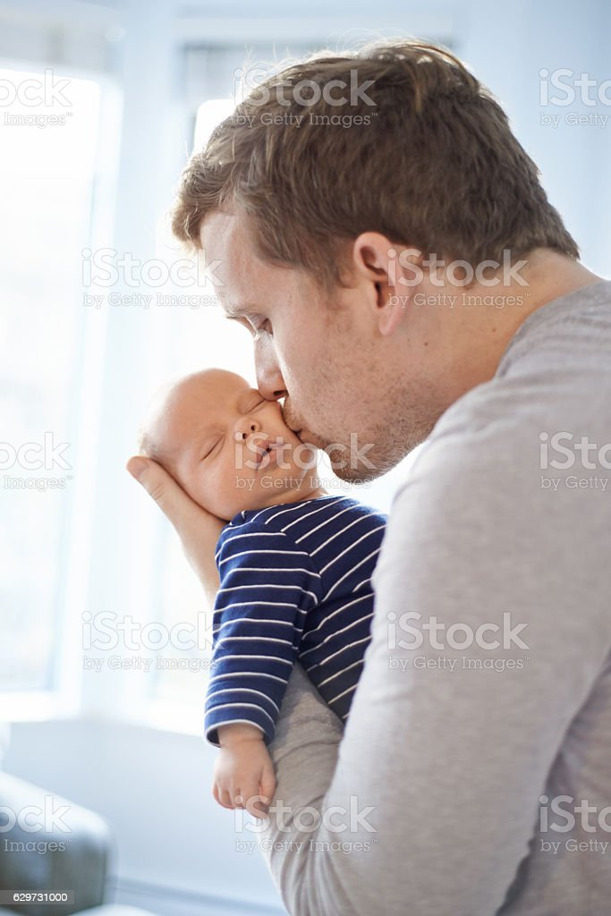 Nothing compares to a father's love for his son stock photo