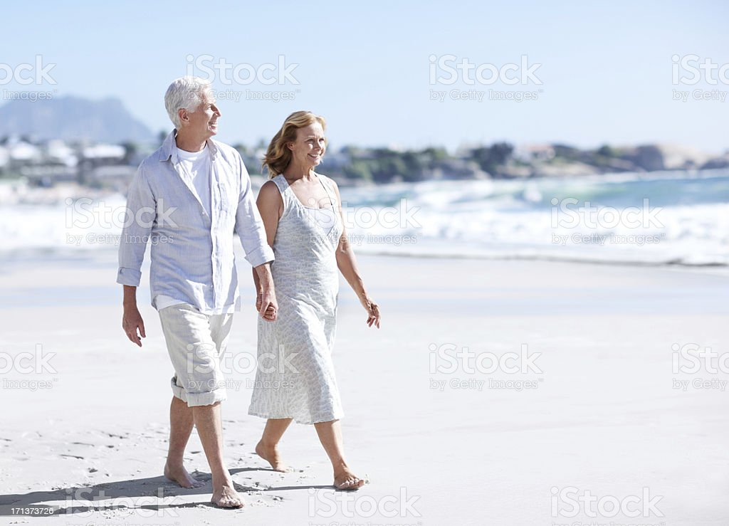 Nothing like a stroll on the beach royalty-free stock photo