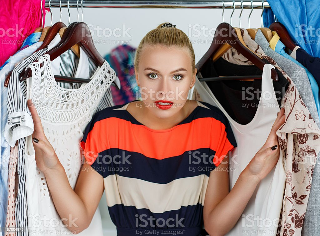 Nothing to wear and hard to decide concept stock photo