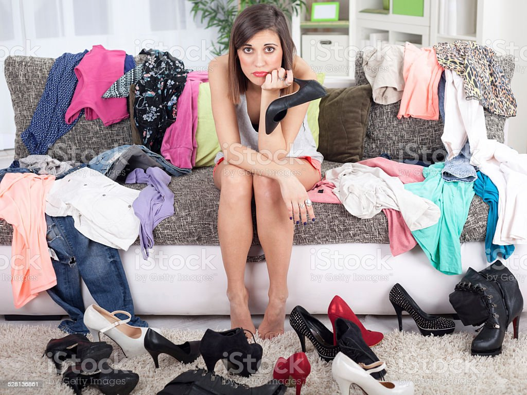 Nothing to wear concept, young woman deciding what to put stock photo