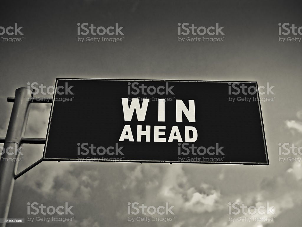 Notice Board On A National Highway Showing Win Ahead, Concept royalty-free stock photo