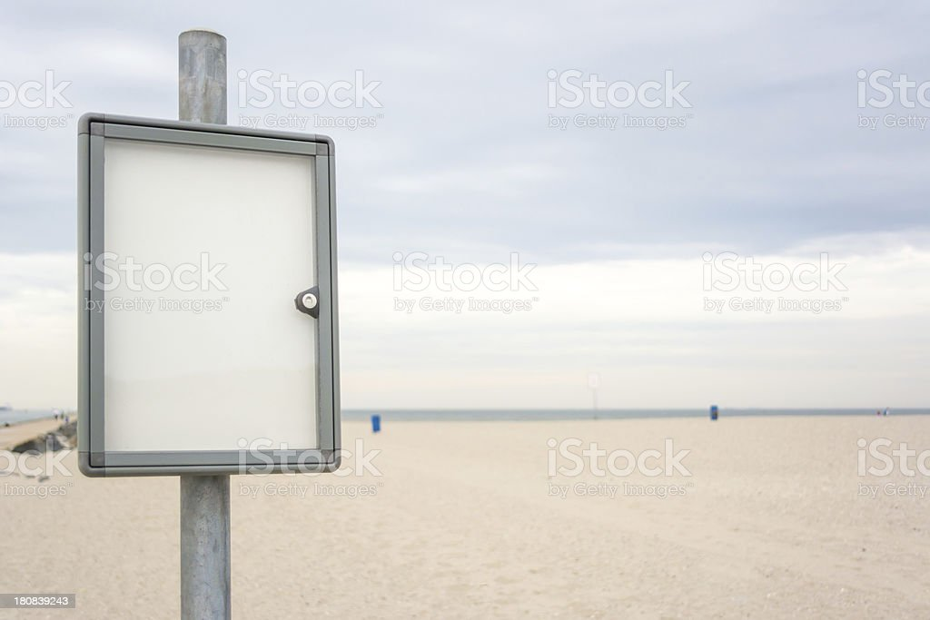 Notice Board on Empty Beach stock photo