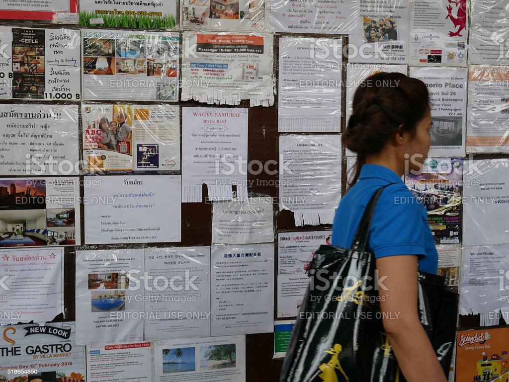 Notice board on the sidewalk in Bangkok stock photo