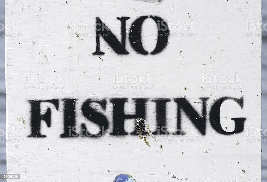 Notice no fishing upside down N stock photo