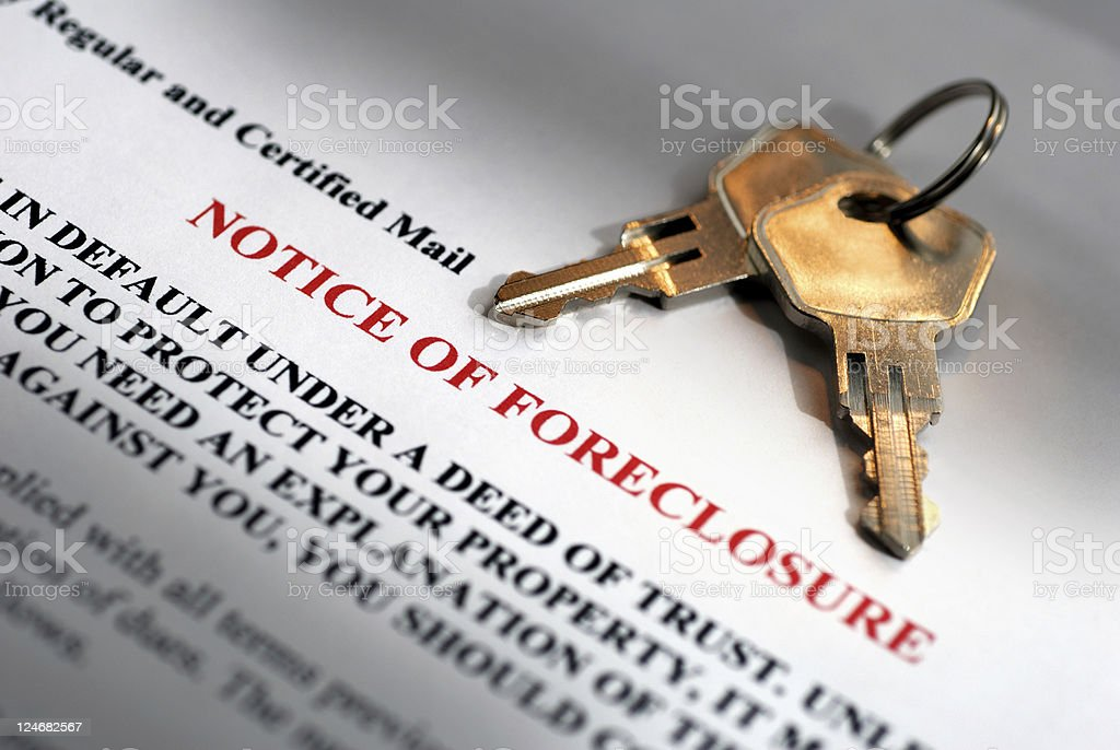 Notice of Foreclosure and House Keys stock photo