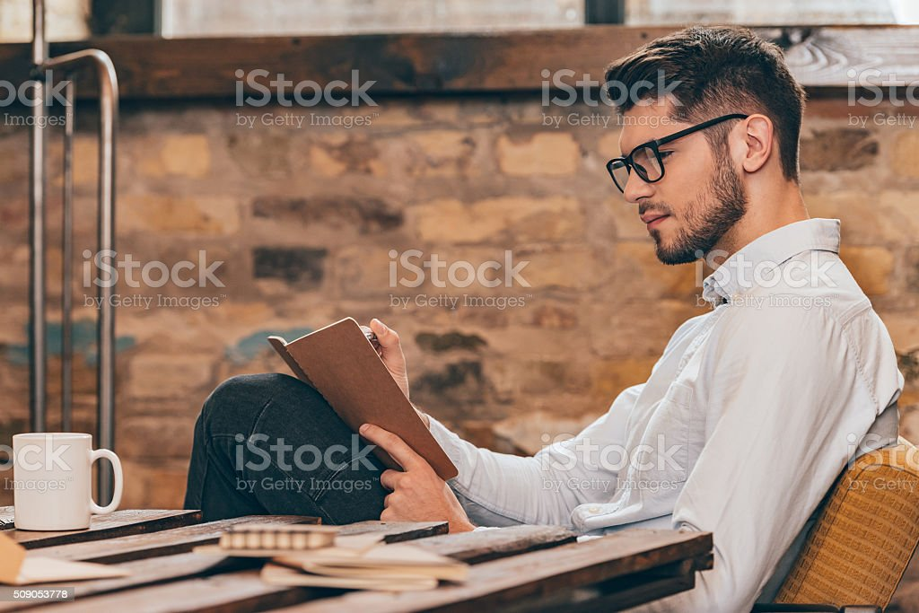 Noting his ideas. stock photo