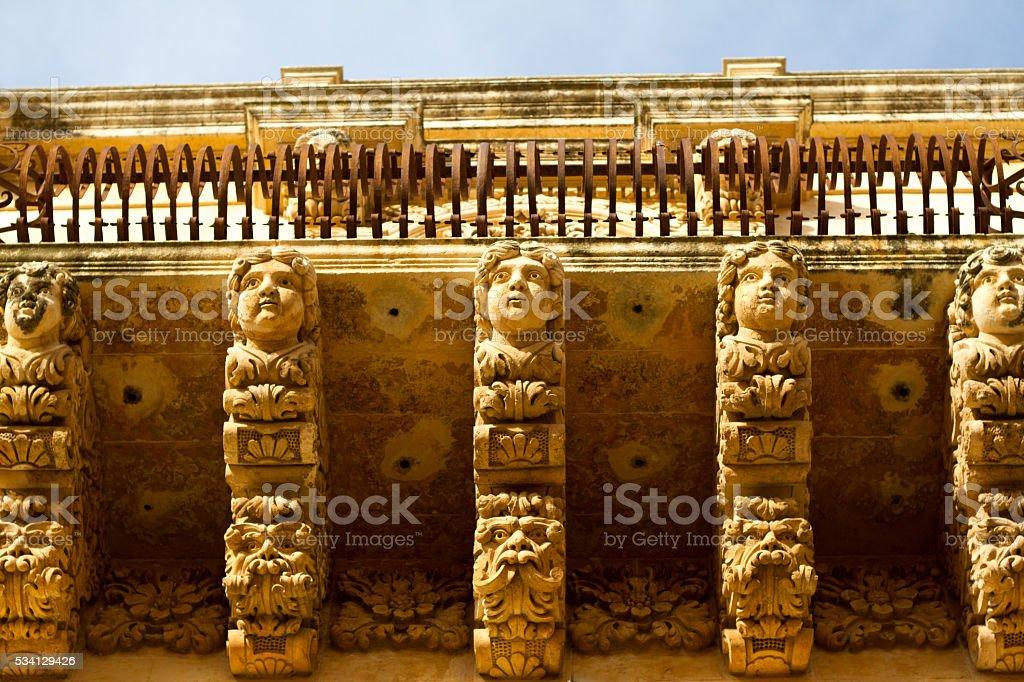 Noto, Sicily: Ornate Baroque Carved Balcony (Close-Up) stock photo