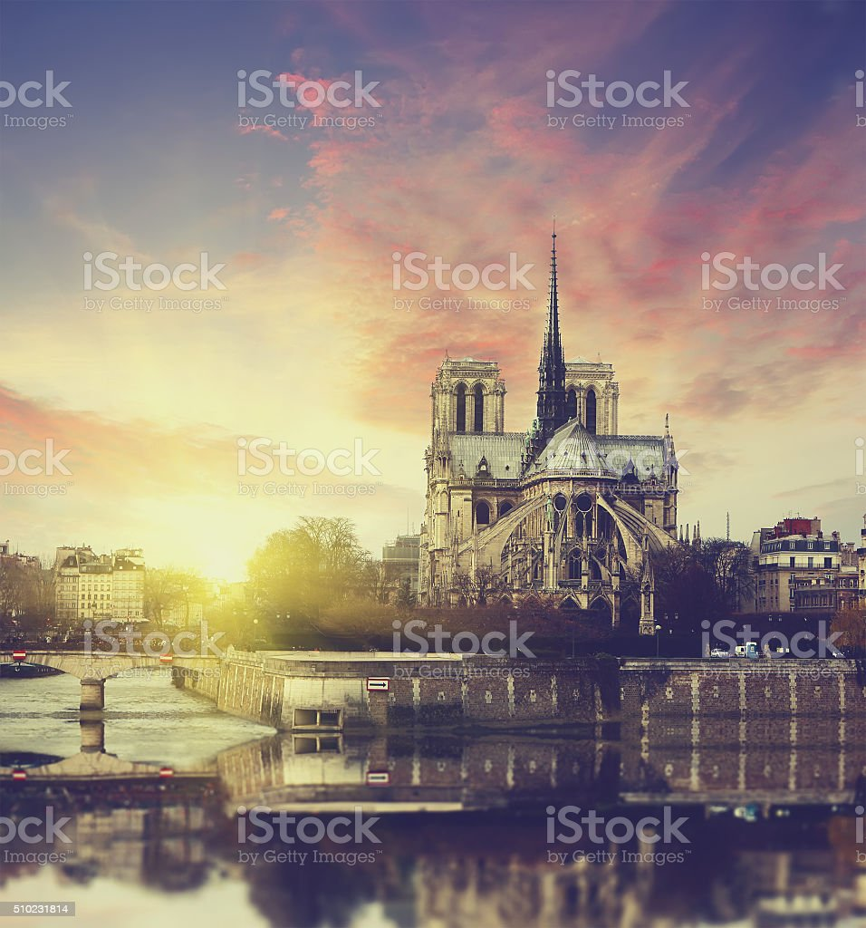 Notre Dame at sunset in Paris , France stock photo