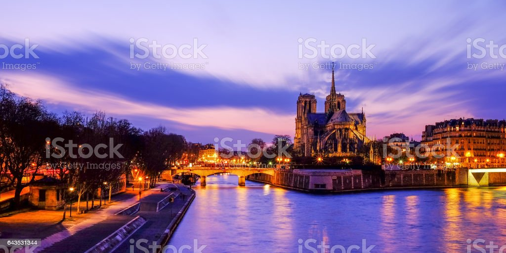 Notre Dame at the river Seine during twilight, Paris, France stock photo