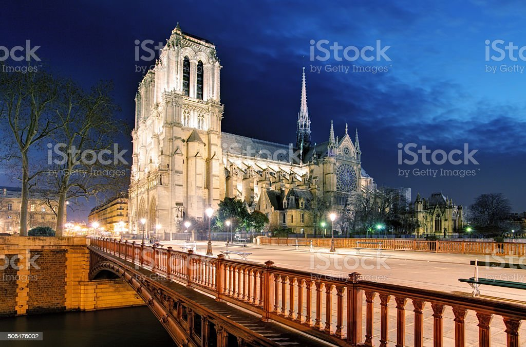 Notre Dame Cathedral at dusk in Paris, France stock photo