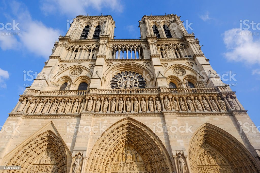 Notre Dame cathedral facade saint statues stock photo
