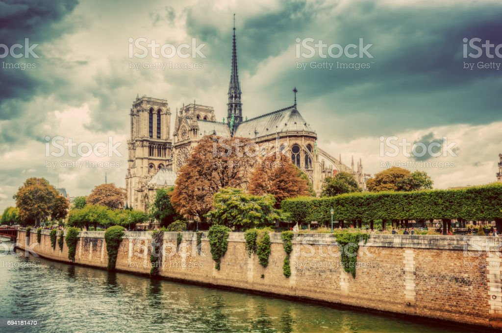 Notre Dame Cathedral in Paris, France and the Seine river. stock photo