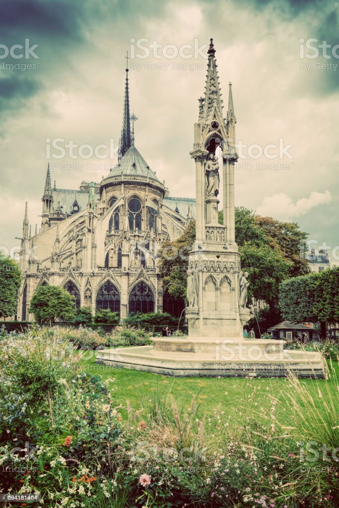 Notre Dame Cathedral in Paris, France. Square Jean XXIII. Vintage stock photo
