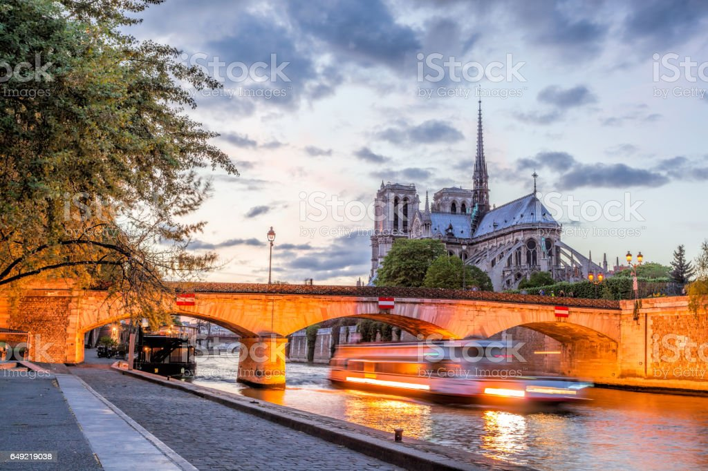 Notre Dame cathedral with boat in the evening, Paris, France stock photo