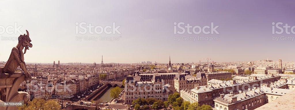 Notre Dame: Chimera (demon) overlooking Paris skyline stock photo
