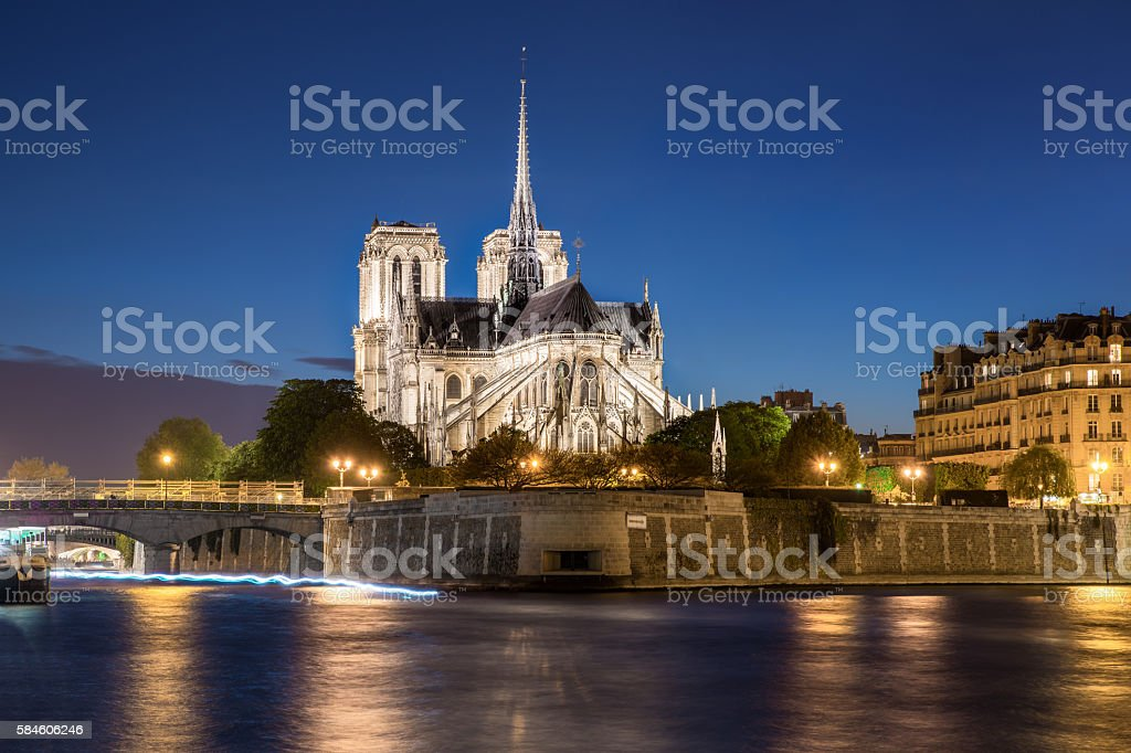 Notre dame de paris cathedral with Seine river in Paris stock photo