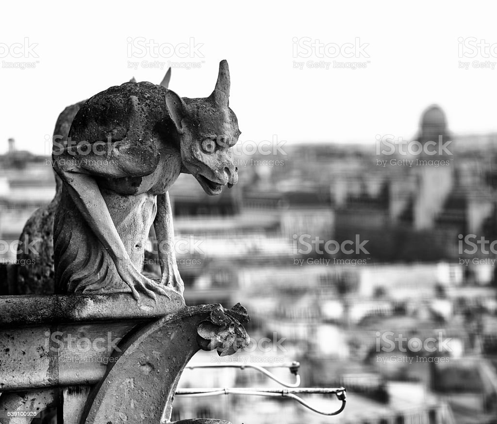 Notre Dame: Gargoyle Statue - BW stock photo