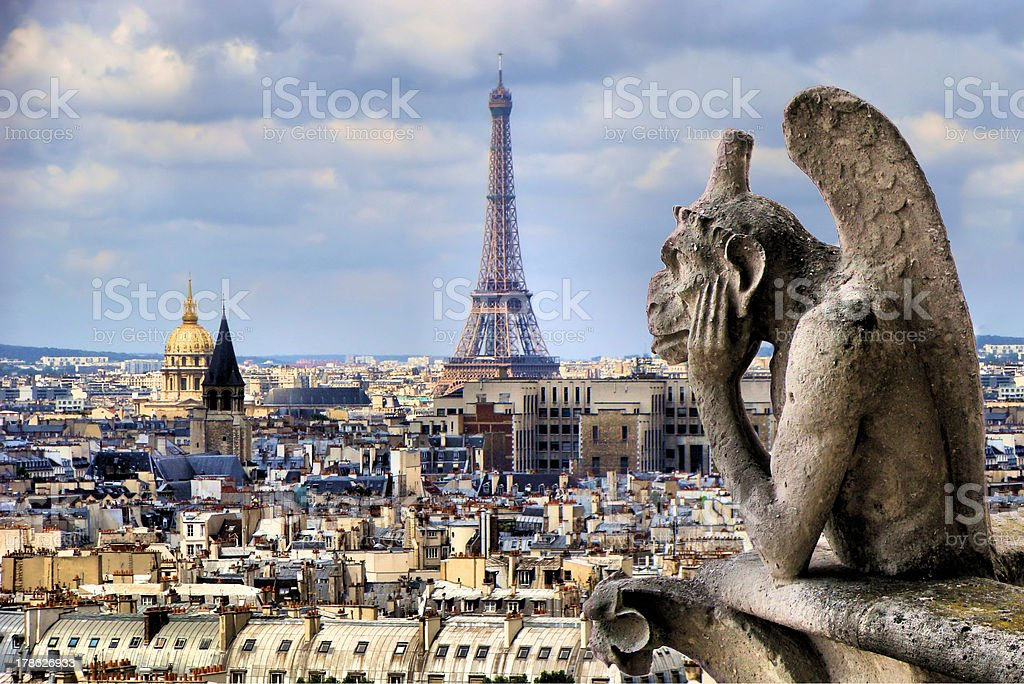 Notre Dame gargoyle with Paris cityscape and Eiffel Tower, France stock photo