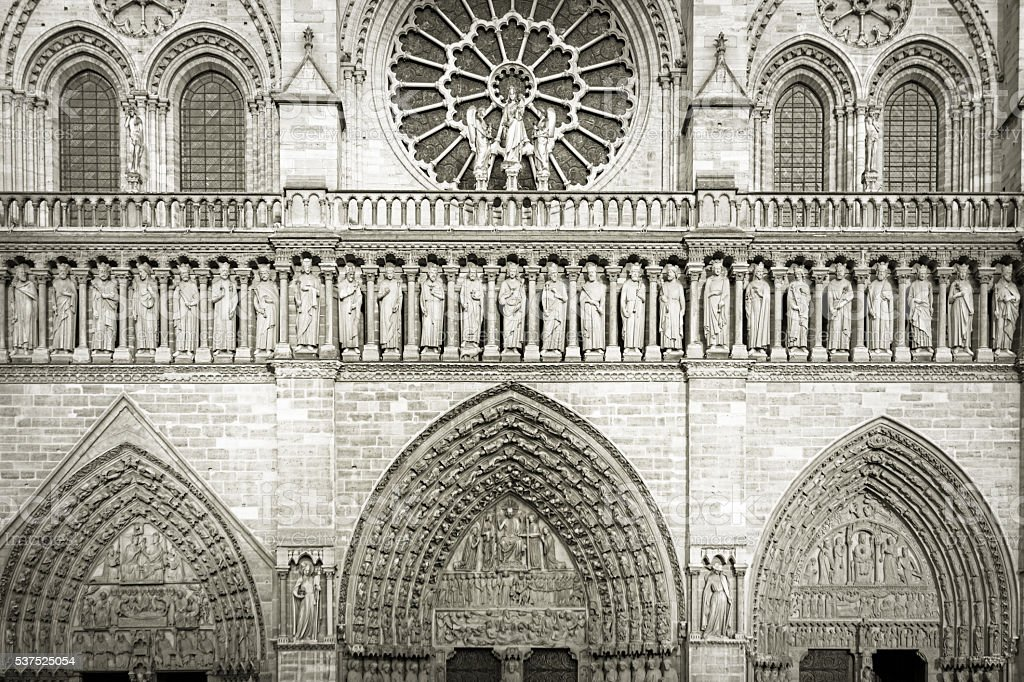 Notre Dame's west rose window partly, and entering doo stock photo