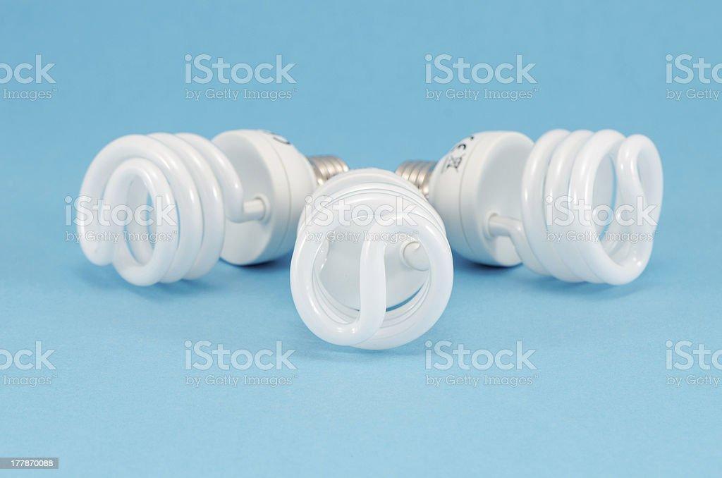 novel new economic fluorescent light bulb stock photo