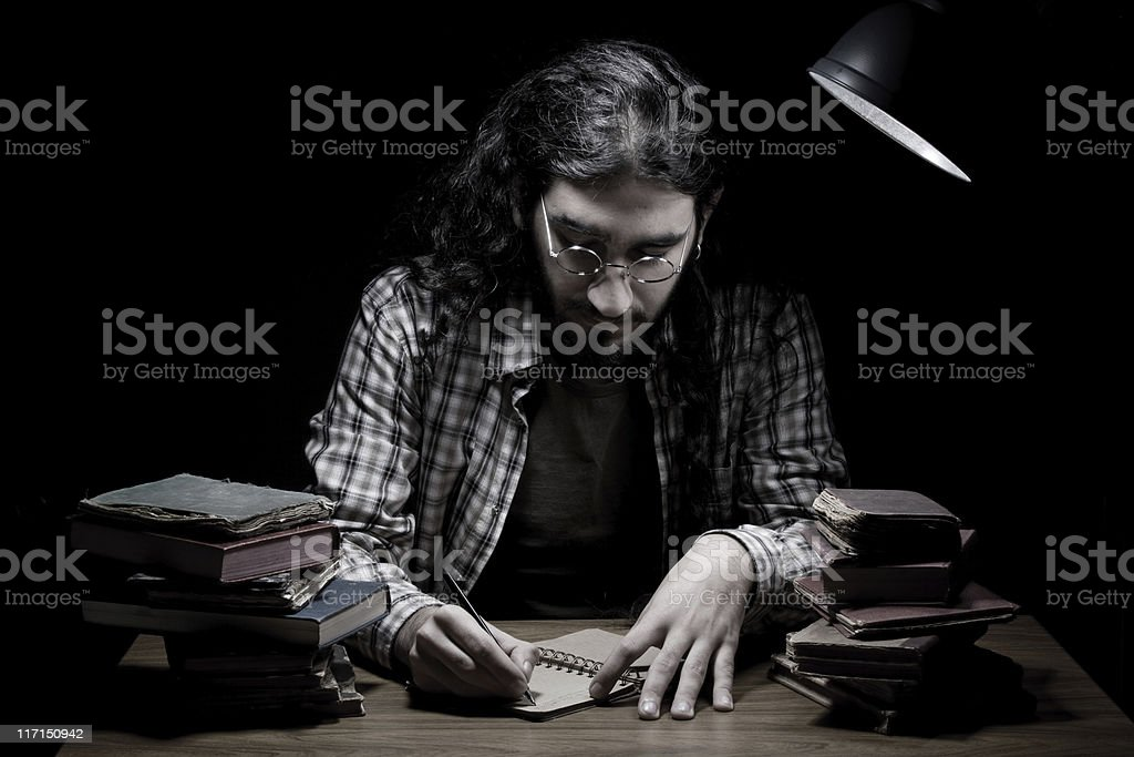 Novelist writing on table in the dark royalty-free stock photo