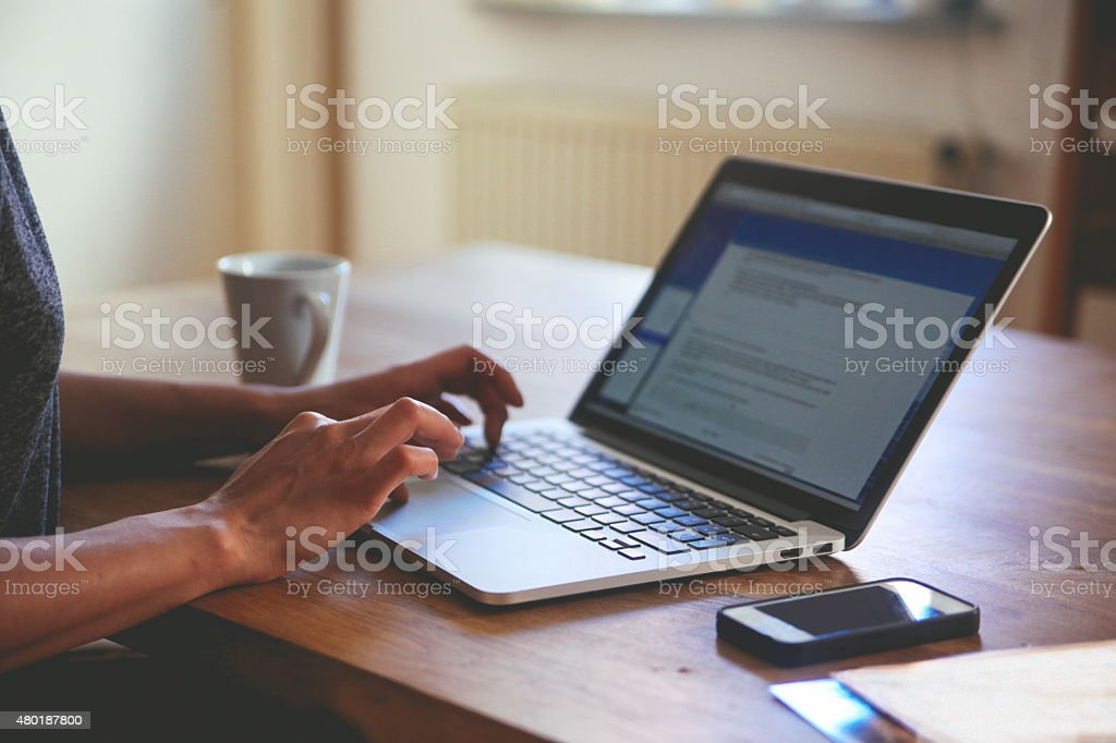 novelist writing on the laptop stock photo