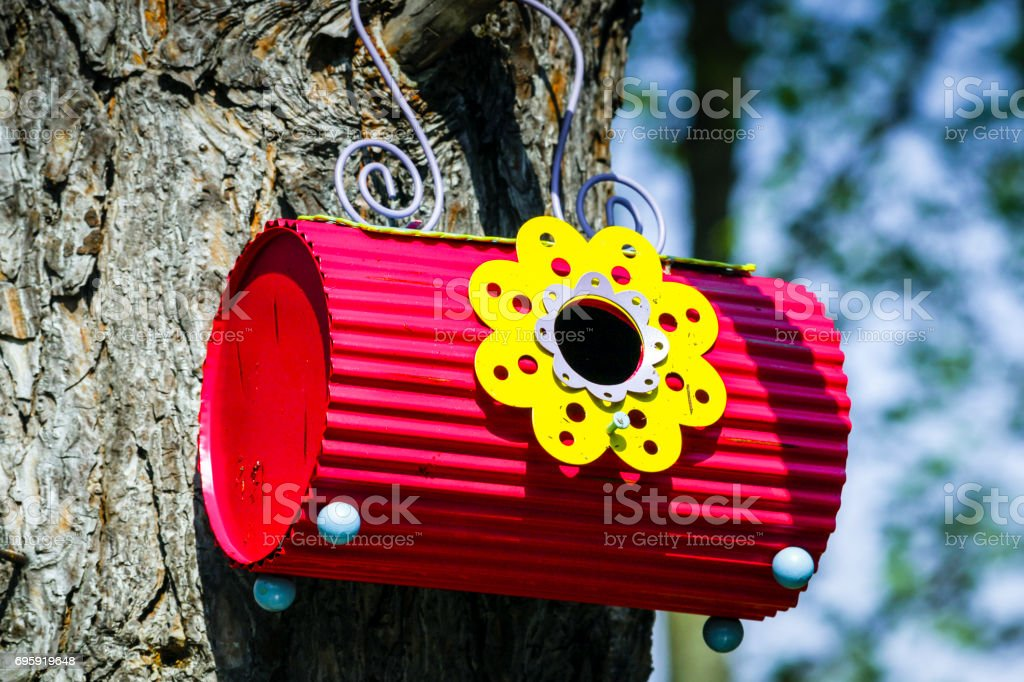 Novelty Ladies handbag style birdhouses attached to a tree in Fort...