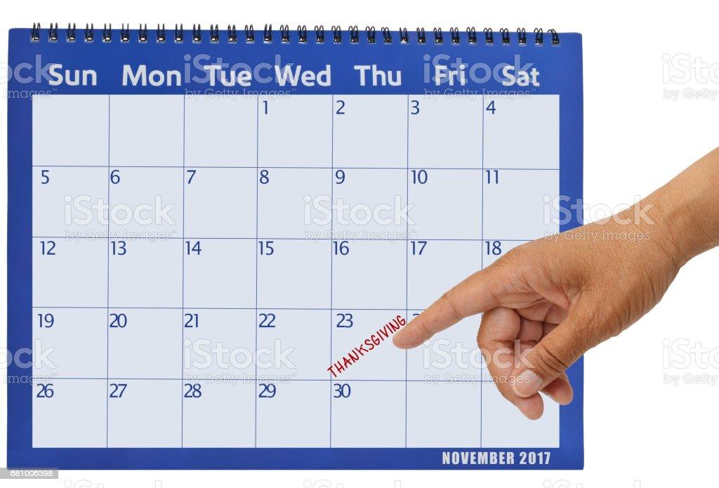November 2017 Calendar Hand Pointing to Thanksgiving stock photo