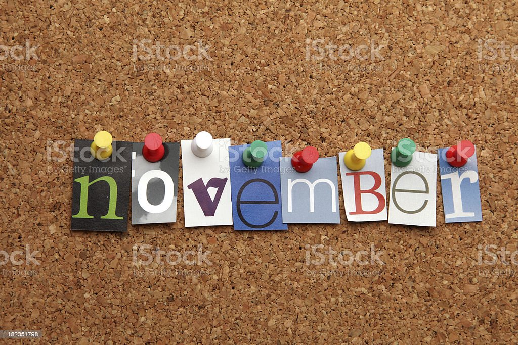November pinned on noticeboard stock photo