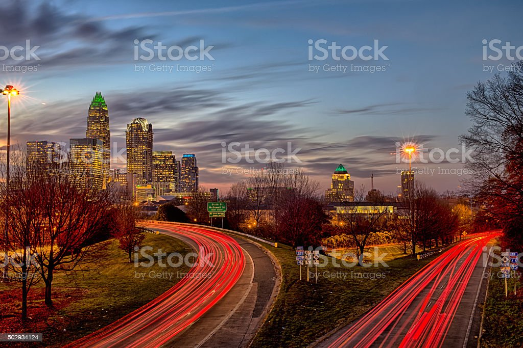 november sun setting over charlotte north carolina skyline stock photo