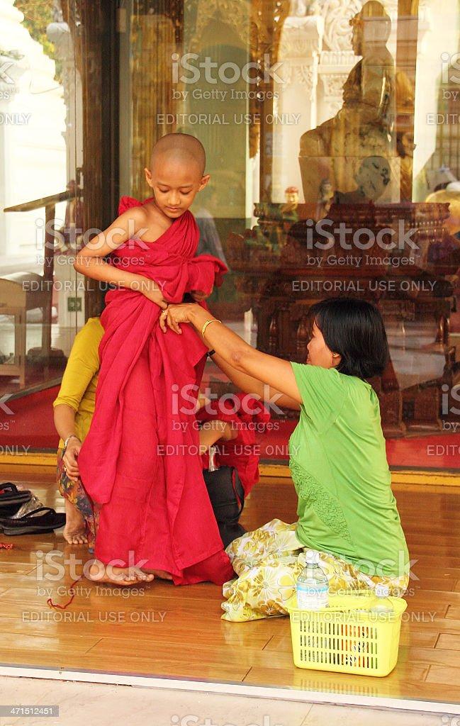 Novice beeing dressed in Shwedagon Pagoda_Yangon royalty-free stock photo