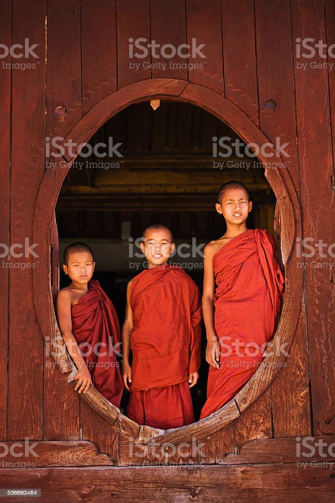 Novice Buddhist monks in Shwe Yaunghwe Kyaung Monastery stock photo