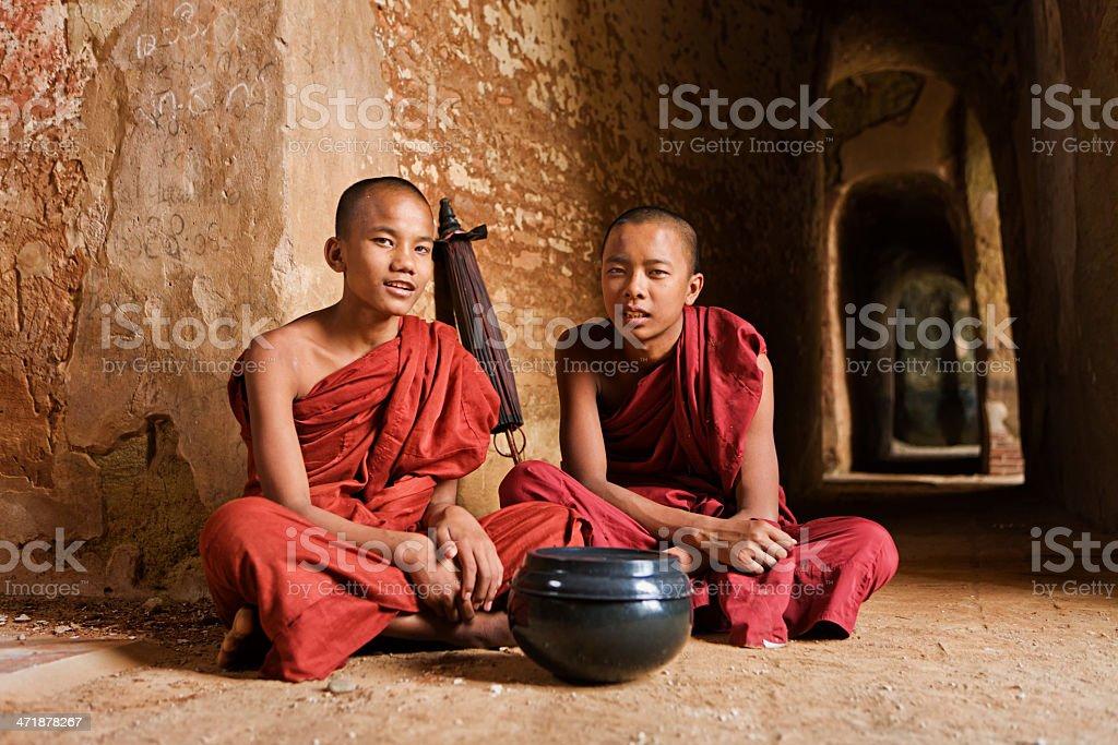 Novice Buddhist monks inside the temple stock photo