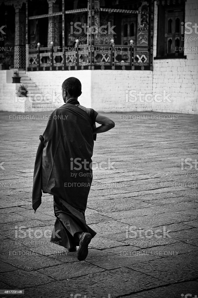 Novice monk of the Tashi Chho Dzong Fortress, Thimpu, Bhutan stock photo
