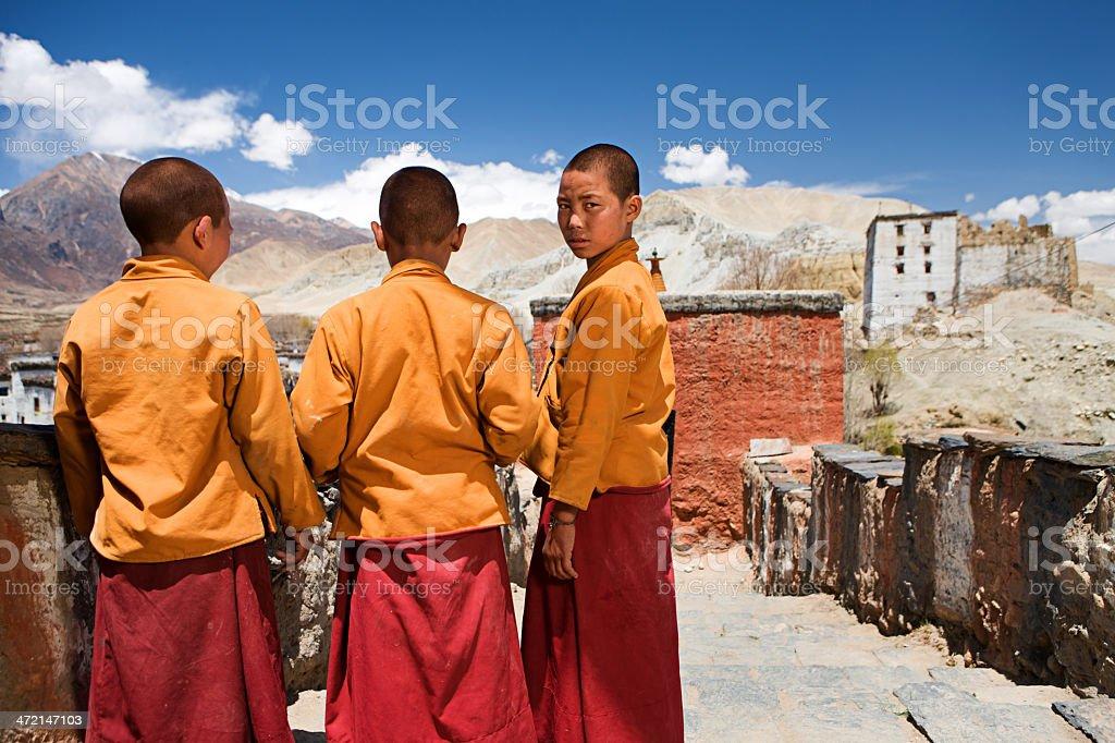 Novice monks in Tibetan monastery. Mustang. stock photo