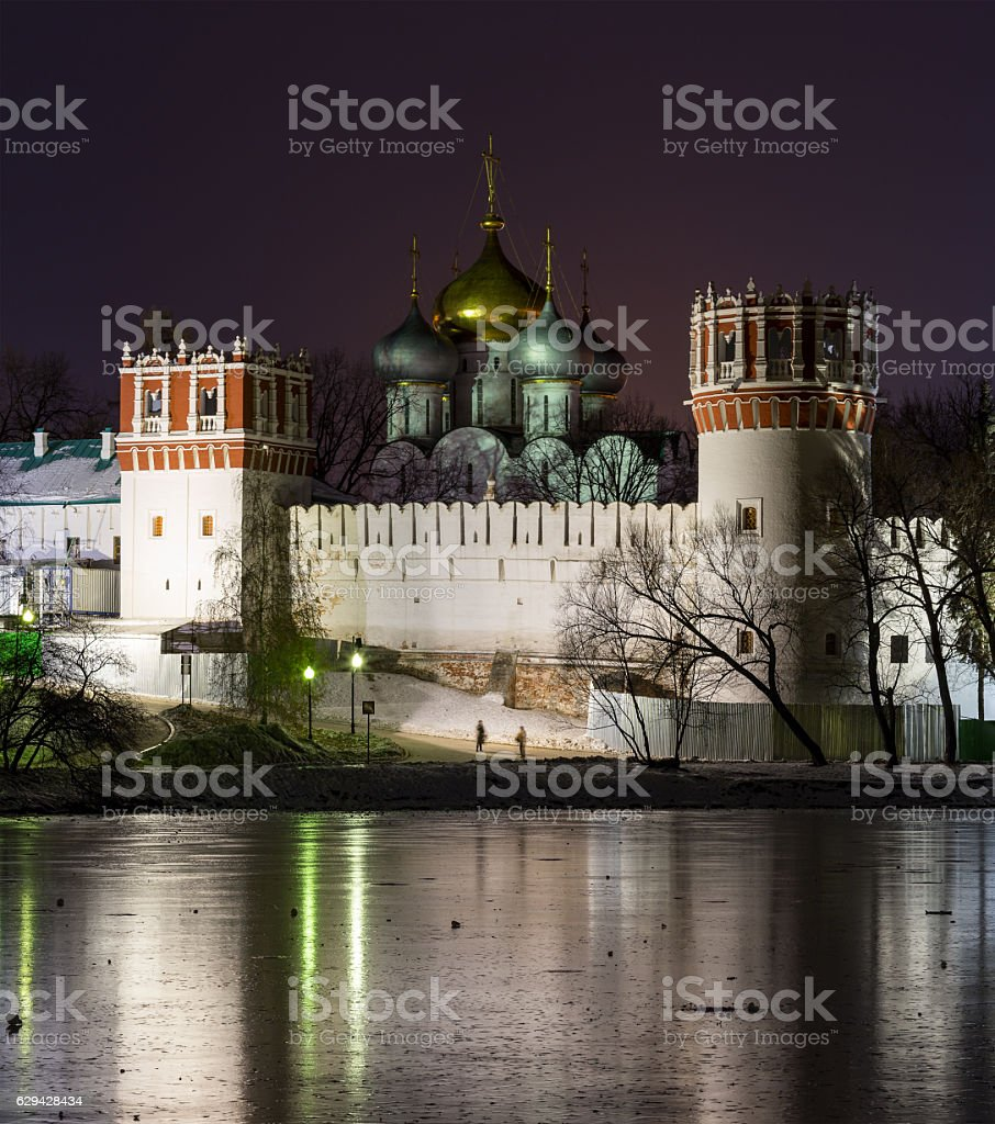 Novodevichy Convent at night with reflections in frozen pond stock photo