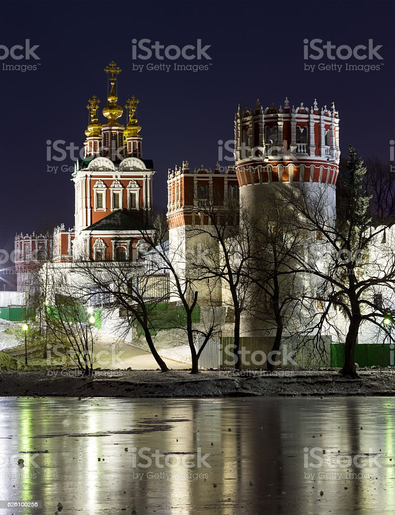 Novodevichy Monastery at night with reflections in frozen pond stock photo