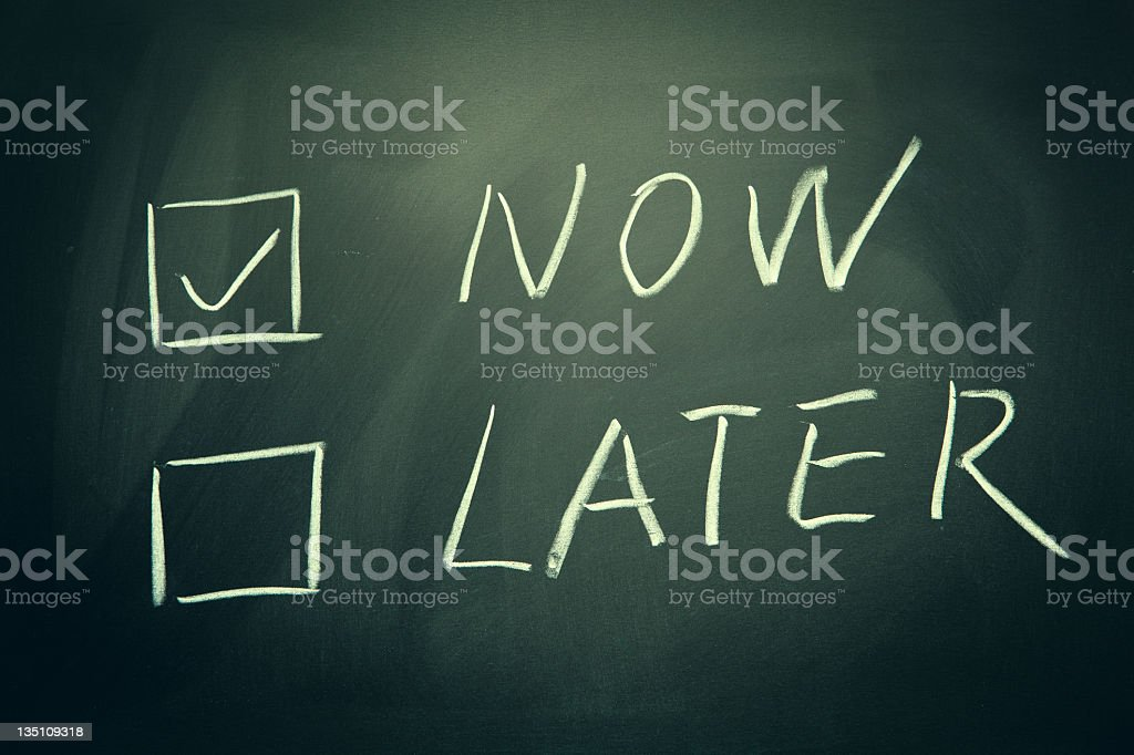 now and later check boxes written on a blackboard. royalty-free stock photo
