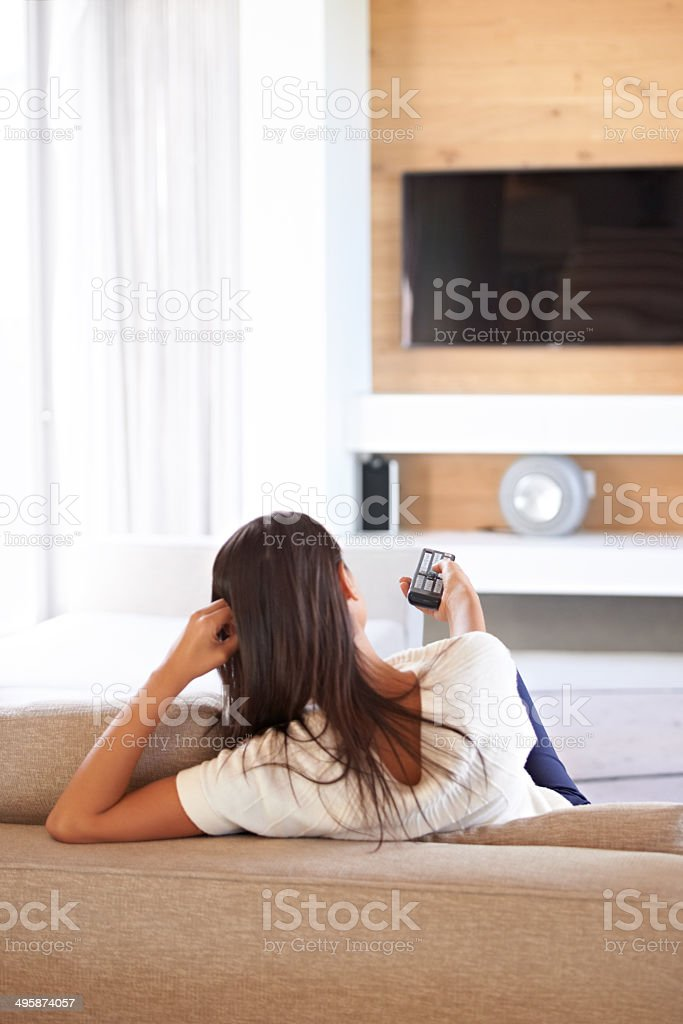 Now for some channel-surfing on the sofa stock photo